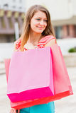 Beautiful Girl With Pink Shopping Bag Royalty Free Stock Photography