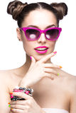 Beautiful girl in pink sunglasses with bright makeup and colorful nails. Beauty face. Royalty Free Stock Image
