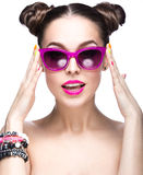 Beautiful girl in pink sunglasses with bright makeup and colorful nails. Beauty face. Stock Photos