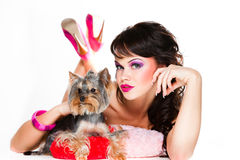 Beautiful girl in pink with yorkshire terrier Royalty Free Stock Photography