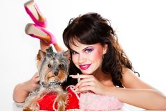 Beautiful girl in pink with yorkshire terrier Royalty Free Stock Image