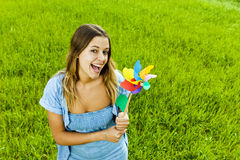 Beautiful girl with a pinwheel Stock Images