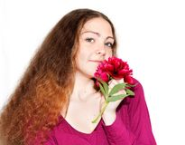 Beautiful girl with a pion in the hands of Royalty Free Stock Image