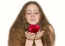 Beautiful girl with a pion in the hands of Royalty Free Stock Photography