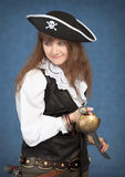 Beautiful girl - pirate on blue background Stock Images