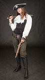 Beautiful girl - pirate with sabre and pistol Stock Images