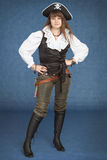 Beautiful girl - pirate stand on blue background Stock Photography