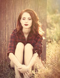 Beautiful girl in plaid dress Stock Image