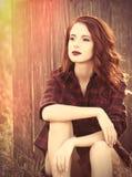 Beautiful girl in plaid dress Stock Photos