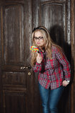 Beautiful girl in a plaid shirt and candy on a stick Royalty Free Stock Images
