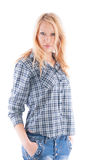 Beautiful girl in a plaid shirt and jeans stock photos