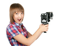 Beautiful girl in plaid shirt with movie camera Royalty Free Stock Photo