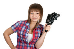 Beautiful girl in plaid shirt with movie camera Stock Photo