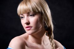 The beautiful girl with a plait against Royalty Free Stock Photo