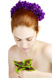 Beautiful girl with a plant in the hands of Stock Images