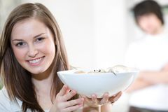 Beautiful girl with plate and boy Stock Photography
