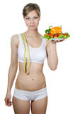 The beautiful girl with a plate with vegetables Stock Image