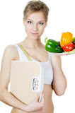 The beautiful girl with a plate with vegetables Royalty Free Stock Images