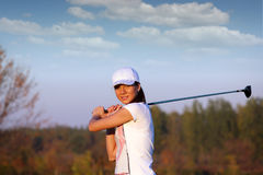 Beautiful girl play golf Royalty Free Stock Images