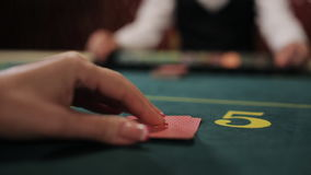 Beautiful girl the player makes a bet in poker and wins. stock video