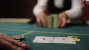 Beautiful girl the player makes a bet in poker and wins. stock video footage