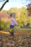 Beautiful girl playing. Beautiful little girl playing in an autumn park Stock Photography