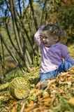 Beautiful girl playing. Beautiful little girl playing in an autumn park Royalty Free Stock Images