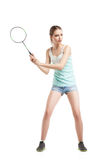 Beautiful girl playing with badminton racket Stock Photos