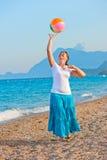 Beautiful girl playing on the beach ball. Beautiful girl playing  on the beach ball Stock Photography