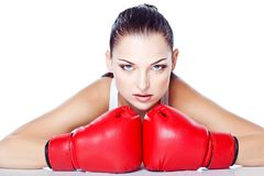 Trained girl playing box in red gloves. Beautiful girl playing box in red gloves and white top Royalty Free Stock Photos