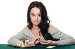 The beautiful girl with playing card Stock Photo