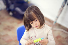 Beautiful  girl playing with dough Stock Images