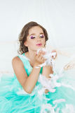 Beautiful girl playing with feathers Royalty Free Stock Photography