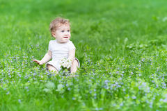 Beautiful girl playing with flowers Royalty Free Stock Photos