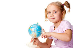 Beautiful girl playing with a globe Royalty Free Stock Image
