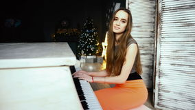 Beautiful girl playing on the grand piano stock footage