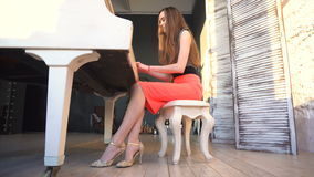 Beautiful girl playing on the grand piano stock video footage