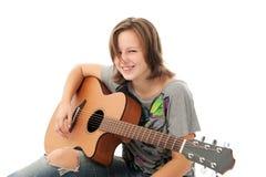 Beautiful Girl playing guitar Royalty Free Stock Photo