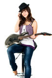 Beautiful girl playing the guitar Royalty Free Stock Images