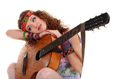 Beautiful Girl playing guitar Stock Images