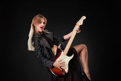 Beautiful girl playing guitar Royalty Free Stock Images
