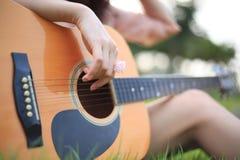Beautiful girl playing guitar . Royalty Free Stock Image