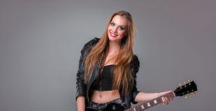 Beautiful girl playing guitar Royalty Free Stock Photography