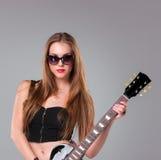Beautiful girl playing guitar Stock Photography