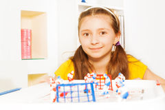 Beautiful girl playing ice hockey table board game Royalty Free Stock Photography