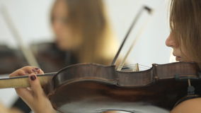 Beautiful girl playing the violin in front of her stock video