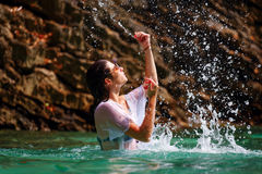 Beautiful girl playing with water Stock Photos