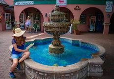 Beautiful girl playing with water fountain in Florida`s Historic Coast . royalty free stock photos