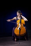 Beautiful girl plays the cello. Stock Image