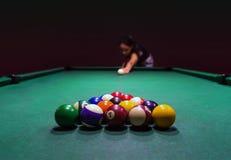 Beautiful girl plays pool stock images